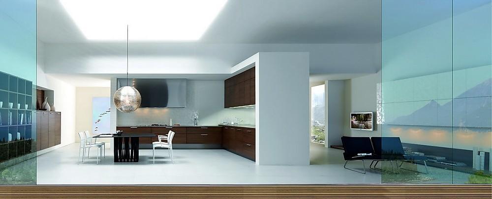 cocina abierta con estanteria en nogal y sala de estar con
