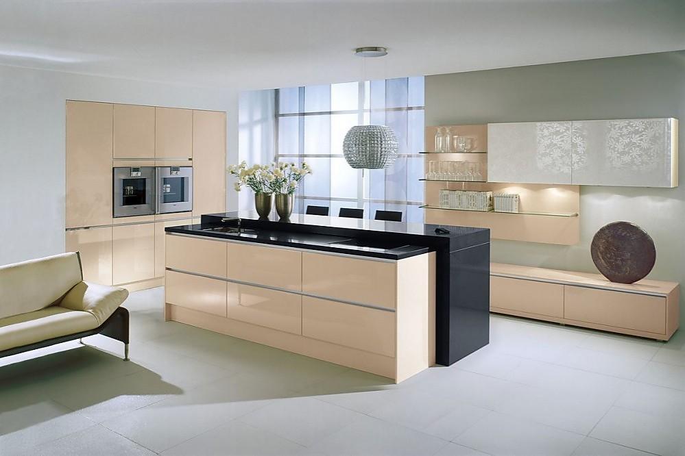 Isla de cocina con placa de cocci n regulable y aparador for Cocinas modernas con isla central y desayunador